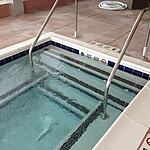 Commercial gunite Hot Tub with white safety grip coping